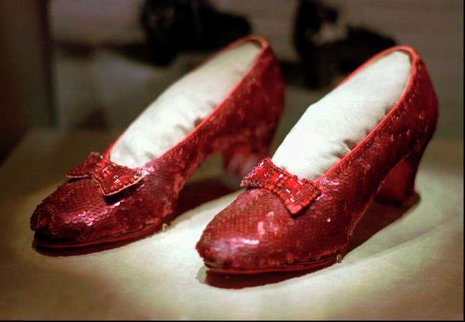 "FILE - In this April 10, 1996 file photo, the ruby slippers worn by Judy Garland in the 1939 film ""The Wizard of Oz"" are shown on display during a media tour of the ""America's Smithsonian"" exhibition in Kansas City, Mo. The ruby slippers are leaving the U.S. on their first international journey to London's Victoria and Albert Museum. (AP Photo/Ed Zurga) / AP"