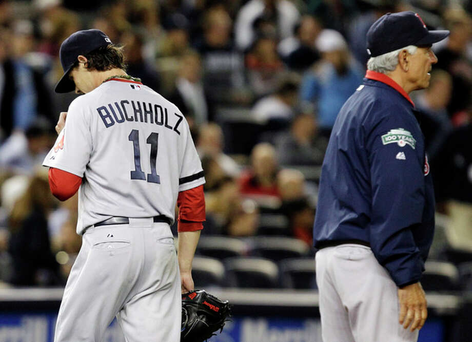 Boston Red Sox starting pitcher Clay Buchholz, left, leaves the mound as manager Bobby Valentine summons a reliever during the second inning of their baseball game against the New York Yankees at Yankee Stadium in New York, Monday, Oct. 1, 2012. (AP Photo/Kathy Willens) / AP