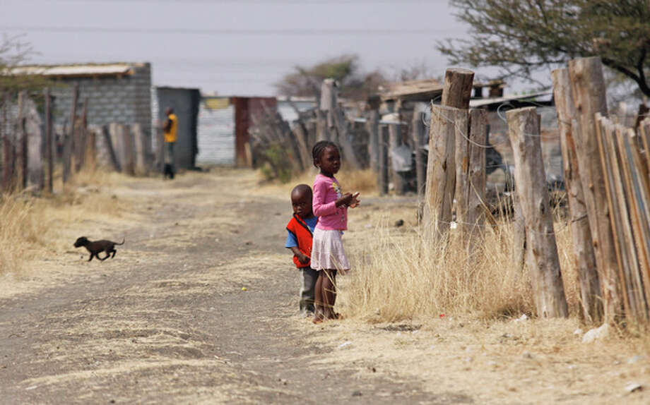 Ap photoIn this photo taken Tuesday, Aug. 28 children walk among miners shacks in the Wonderkop settlement next to the Lonmin Platinum Mine near Rustenburg, South Africa. / AP
