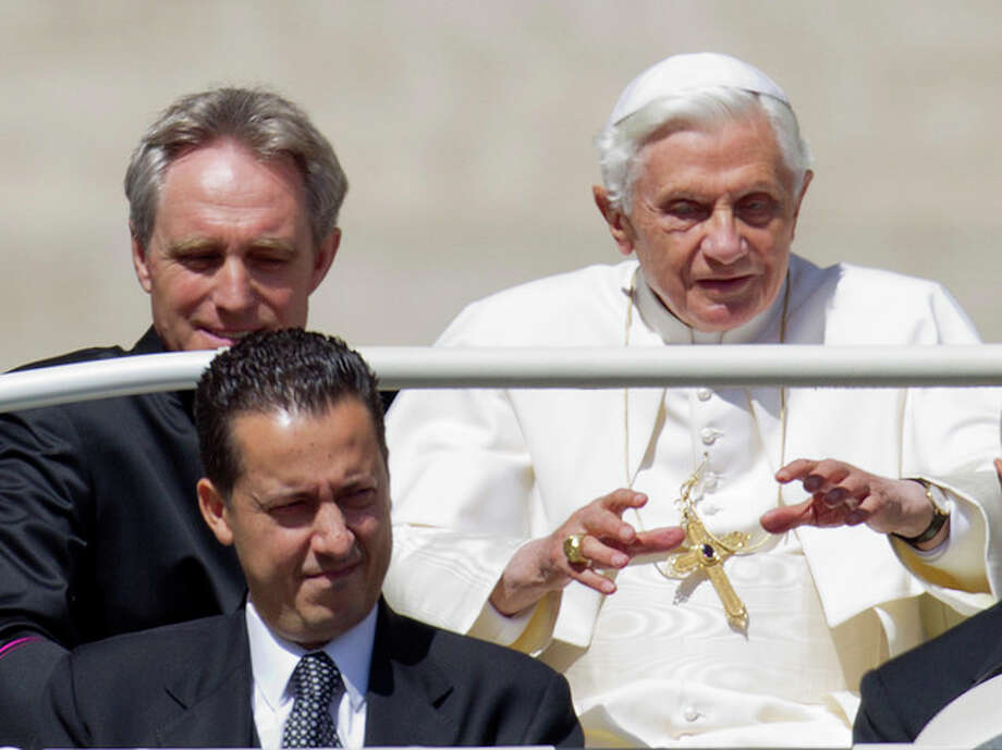 FILE -- In this photo taken Wednesday, May, 23, 2012, Pope Benedict XVI, flanked by his private secretary Georg Gaenswein, top left, and his butler Paolo Gabiele arrives at St.Peter's square at the Vatican for a general audience. Paolo Gabriele took the stand Tuesday, Oct. 2, 2012, in a Vatican courtroom to defend himself against a charge of aggravated theft. He said he is innocent of charges of stealing the pope's private correspondence but acknowledged he feels guilty of betraying the trust of the pontiff, whom he said he loved like a father. In other testimony Tuesday, the pope's private secretary, Monsignor Georg Gaenswein, testified that he began having suspicions about Gabriele after he realized three documents that appeared in the journalist's book could only have come from the office he shared with Gabriele. (AP Photo/Andrew Medichini, File) / AP