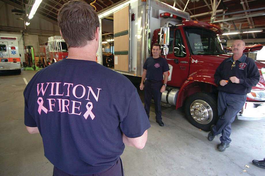 Photo by Alex von KleydorffWilton firefighters wear special T Shirts in support of Breast Cancer awareness month. / 2012 The Hour Newspapers
