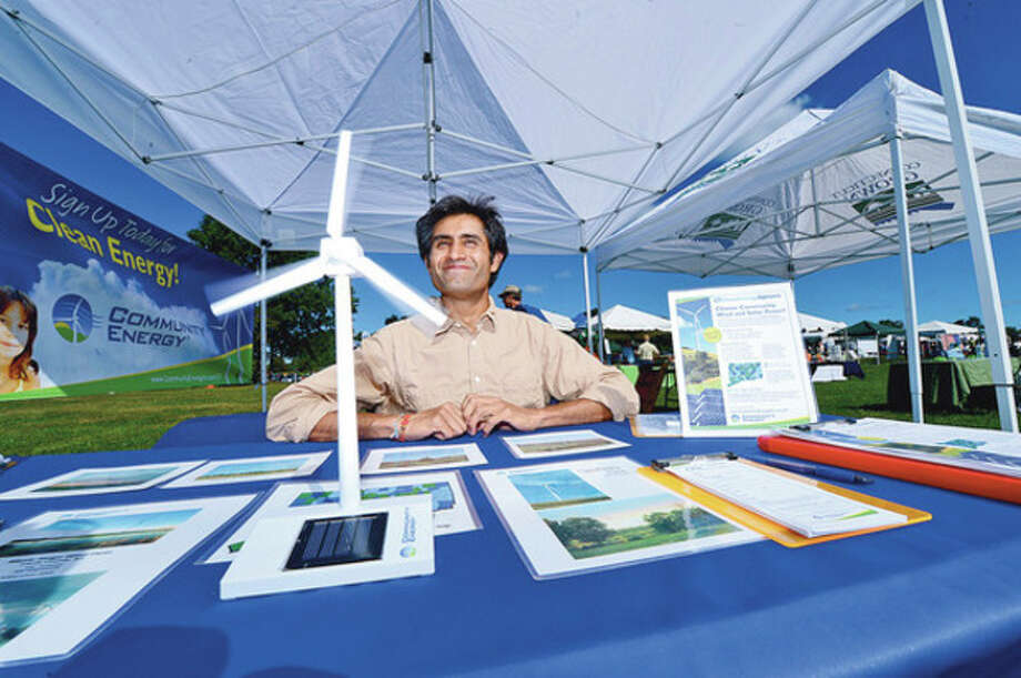 Janak Desai talks about CT Clean Energy Options during the Live Green Connecticut! festival at Taylor Farm Park Saturday where Eco-friendly businesses showcased their green and sustainable products and services.Hour photo / Erik Trautmann / (C)2012, The Hour Newspapers, all rights reserved
