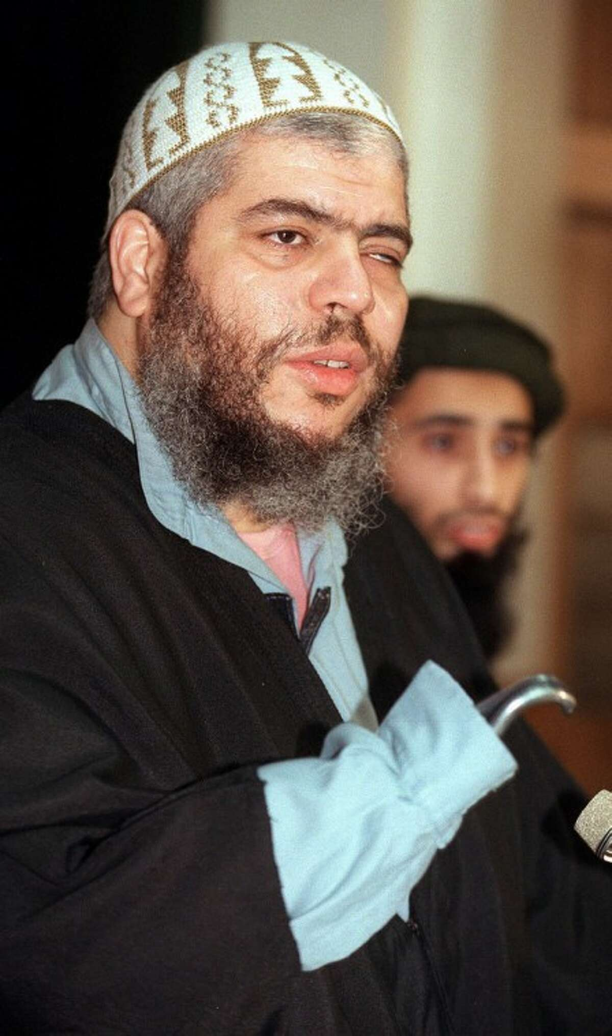 FILE - in this Jan. 20, 1999 file photo, Muslim cleric Abu Hamza al-Masri speaks at a press conference in London . A British court is expected to rule on whether extremist cleric Abu Hamza al-Masri is too ill to be extradited to the United States to face terror charges. London's High Court is set to decide Friday Oct. 5, 2012 whether al-Masri and other terror suspects can be sent to the U.S. to face charges that include helping set up a terrorist training camp in rural Oregon. (AP Photo/Alastair Grant, File)