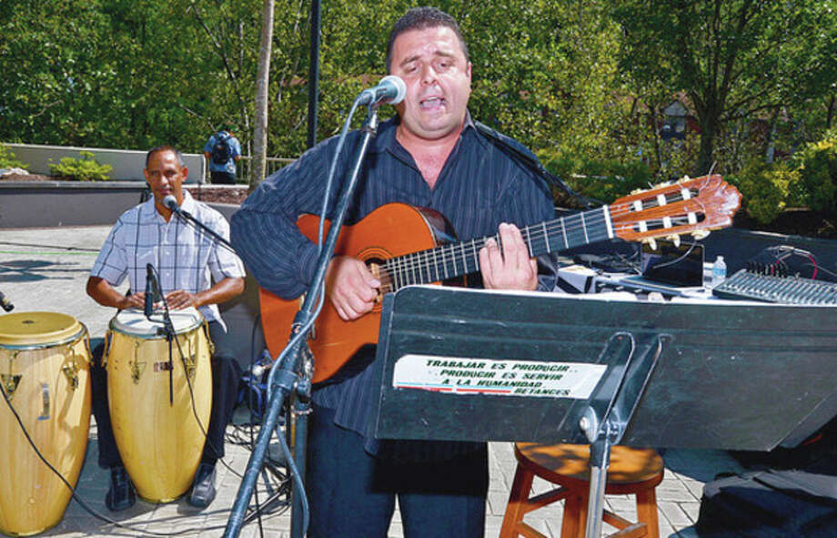 Gilbertio Rivera sings at the Merritt 7 Corporate Park annual Tenant Appreciation Day Wednesday.Hour photo / Erik Trautmann / (C)2012, The Hour Newspapers, all rights reserved