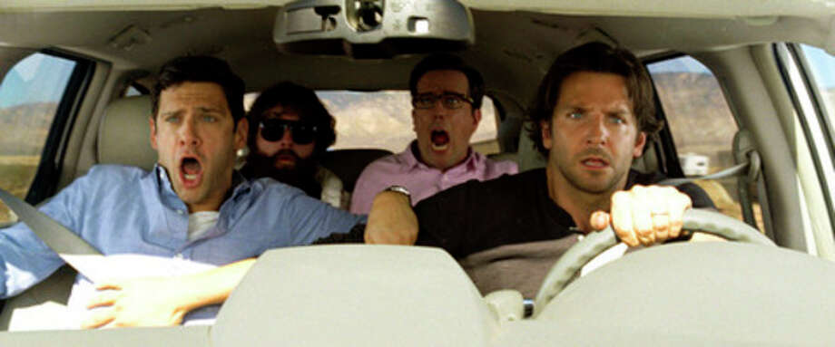 "This undated publicity photo released by courtesy of Warner Bros. Pictures shows, from left, Justin Bartha as Doug, Zach Galfianakis as Alan, Ed Helms as Stu and Bradley Cooper as Phil in Warner Bros. Pictures' and Legendary Pictures' comedy ""The Hangover Part III,"" a Warner Bros. Pictures release. (AP Photo/Warner Bros. Pictures) / Courtesy Warner Bros. Pictures"