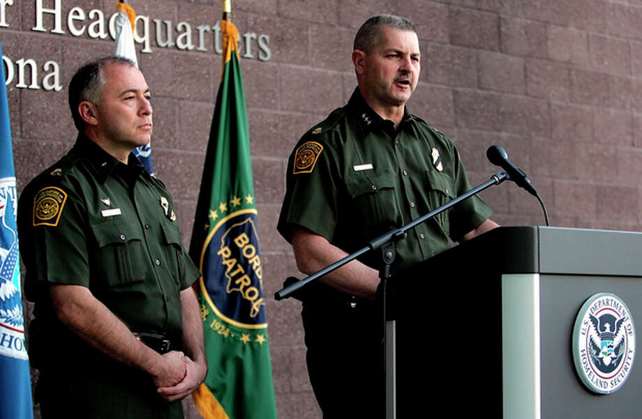 Cmdr. Jeffrey Self, of U.S. Customs and Border Protection, flanked to his left by Acting Chief Patrol Agent Manuel Padilla, releases a statement on Friday, Oct. 5, 2012, at the Tucson Sector Headquarters in Tucson, Ariz. A preliminary investigation has found friendly fire likely was to blame in a shooting that killed U.S. Border Patrol Agent Nicholas J. Ivie and wounded another along the Arizona-Mexico border, the FBI said Friday, shaking up the probe into an incident that re-ignited the political debate over security on the border. (AP Photo/Arizona Daily Star, Mike Christy) ALL LOCAL TV OUT; PAC-12 OUT; MANDATORY CREDIT / Arizona Daily Star