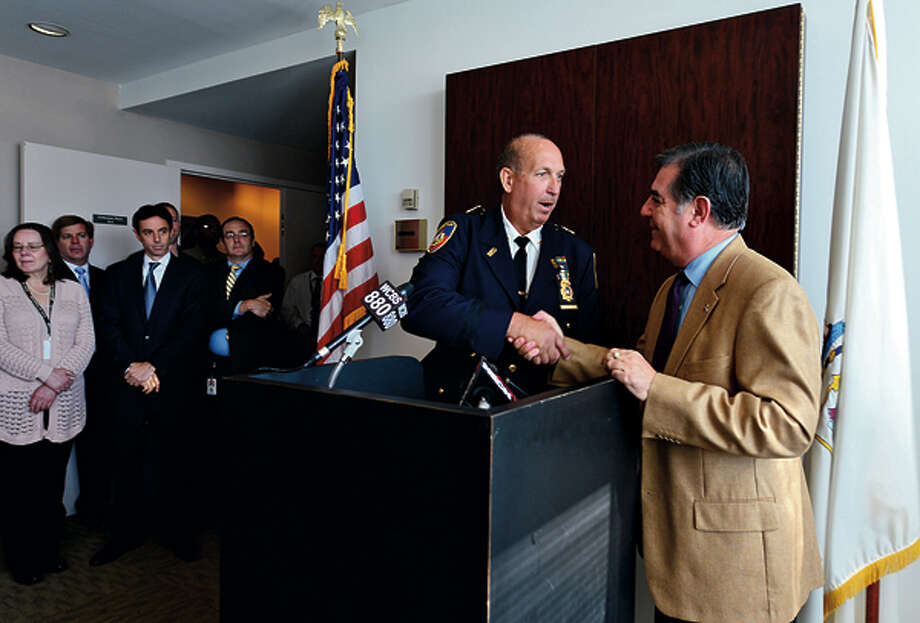 Stamford Mayor Michael Pavia congratulates Jonathan Fontneau after naming him as police chief during a brief press conference Friday morning. Hour photo / Erik Trautmann / (C)2012, The Hour Newspapers, all rights reserved