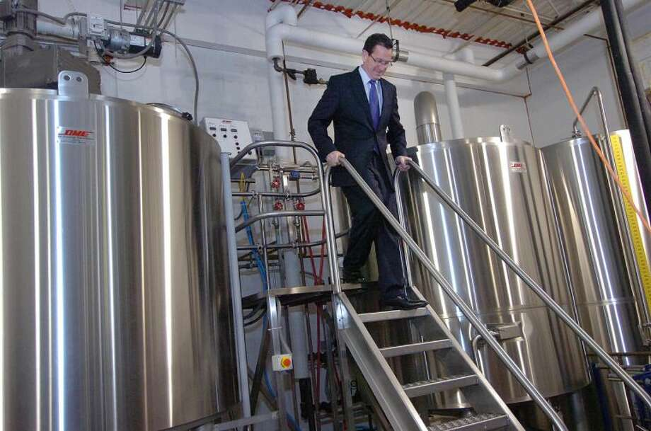 Hour Photo/ Alex von Kleydorff. Gov. Malloy takeas a closer look at at The Mash Tun and the Kettle during a visit to Half Full Brewery in Stamford