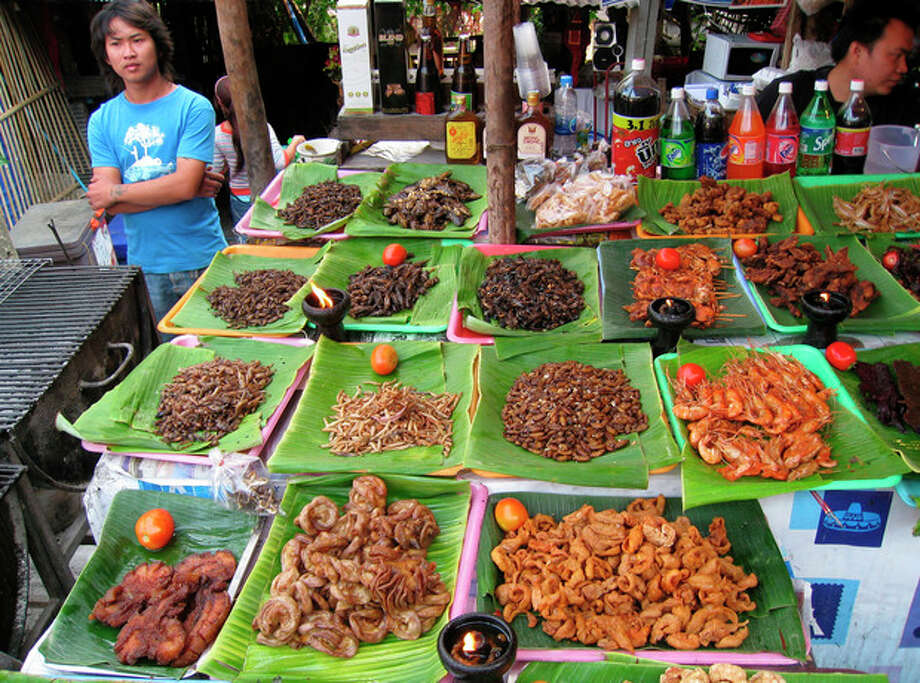This Feb. 20, 2008 photo provided by the United Nations Food and Agriculture Organization (FAO) shows insects for sale at a market in Chiang Mai, Thailand. The U.N. has new weapons to fight hunger, boost nutrition and reduce pollution, and they might be crawling or flying near you right now: edible insects. The Food and Agriculture Organization on Monday, May 13, 2013, hailed the likes of grasshoppers, ants and other members of the insect world as an underutilized food for people, livestock and pets. A 200-page report, released at a news conference at the U.N. agency's Rome headquarters, says 2 billion people worldwide already supplement their diets with insects, which are high in protein and minerals, and have environmental benefits. (AP Photo/Arnold Van Huis, FAO, ho) / FAO