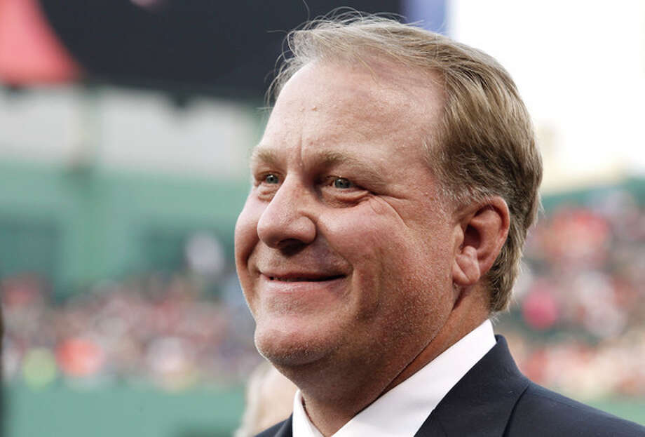 FILE - This Aug. 3, 2012 file photo shows former Boston Red Sox pitcher Curt Schilling smiling after being introduced as a new member of the Boston Red Sox Hall of Fame before the baseball game between the Boston Red Sox and the Minnesota Twins at Fenway Park in Boston. Schilling might have to sell the famed blood-stained sock he wore during the 2004 World Series to cover millions of dollars in loans he guaranteed to his failed video game company. Schilling, whose Providence-based 38 Studios filed for bankruptcy in June, listed the sock as collateral to a bank in a September filing with the Massachusetts Secretary of State. (AP Photo/Winslow Townson, File) / FR170221 AP
