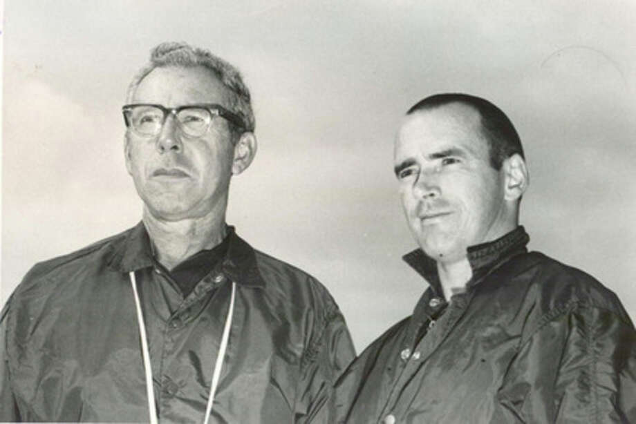 In this undated photo, John Young Squires (left) is seen with an unidentified person