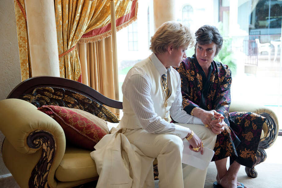 "This film image released by HBO shows Michael Douglas, right, as Liberace, and Matt Damon, as Scott Thorson in a scene from ""Behind the Candalabra,"" a film being shown at the Cannes Film Festival. (AP Photo/HBO, Claudette Barius) / HBO"