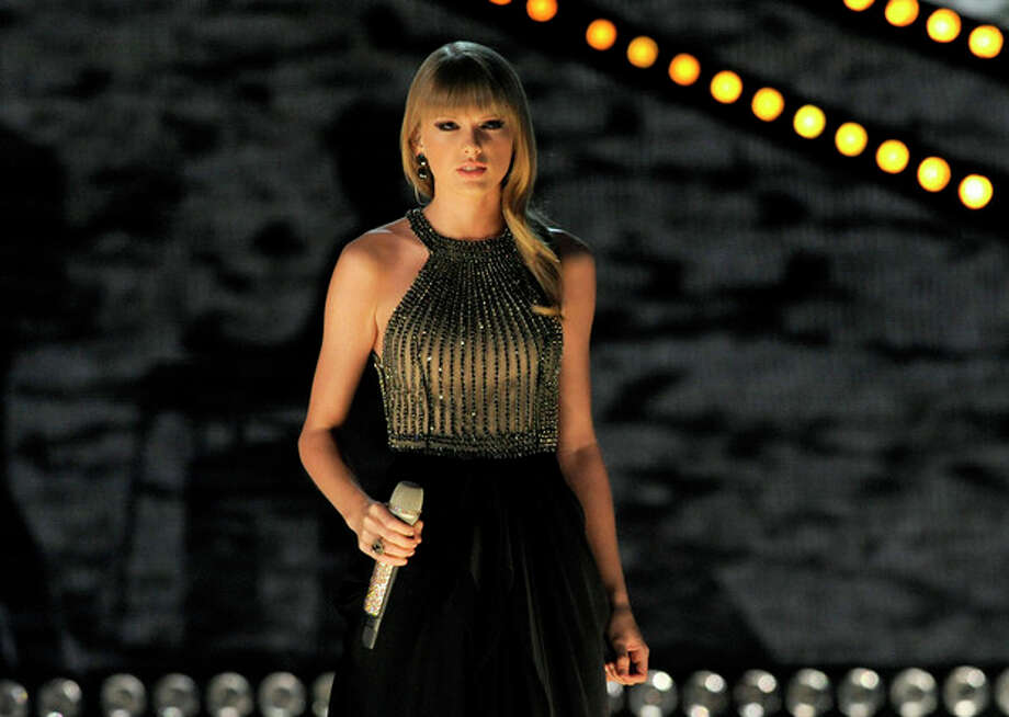 FILE - In this April 7, 2013 file photo, Taylor Swift performs at the 48th Annual Academy of Country Music Awards at the MGM Grand Garden Arena in Las Vegas. Swift, Hunter Hayes, Little Big Town, Luke Bryan and Pistol Annies are set to perform during this year's live show at the 2013 CMT Music Awards. (Photo by Chris Pizzello/Invision/AP, File) / Invision
