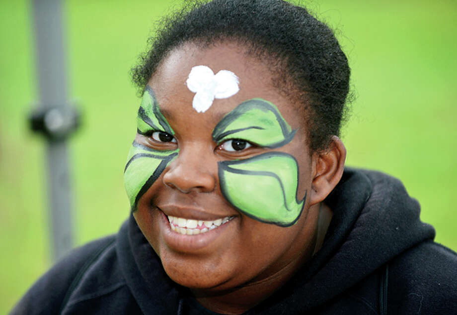 Sharaya Bradley gets her face painted at The 7th annual Norwalk Wilton Tree Festival at Cranbury Park Saturday. Hour photo / Erik Trautmann / (C)2013, The Hour Newspapers, all rights reserved