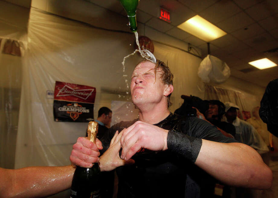 Baltimore Orioles left fielder Nate McLouth celebrates winning the American League wild-card playoff baseball game 5-1, against the Texas Rangers Saturday, Oct. 6, 2012 in Arlington, Texas. (AP Photo/Tony Gutierrez) / AP