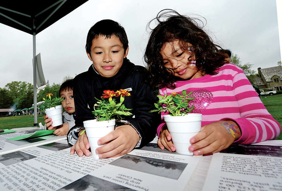 Free samplings and flowers were give out to attendees of The 7th annual Norwalk Wilton Tree Festival at Cranbury Park Saturday including Nicholas Nath, 7, Pricilla Nath, 5, and Leon Nath, 4. Hour photo / Erik Trautmann / (C)2013, The Hour Newspapers, all rights reserved