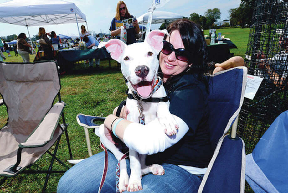 Hour photo / Erik TrautmannRachel Pagliarulo and Thor of Bully Breed Rescue greet people and their pets as they enjoy the PAWS 50th Anniversary Festival at Taylor Farm Park in Norwalk Saturday. / (C)2012, The Hour Newspapers, all rights reserved