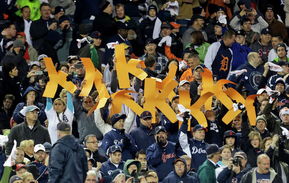 Detroit Tigers fans hold up strikeout K's for starting pitcher Justin Verlander during the fifth inning of Game 1 of the American League division baseball series against the Oakland Athletics, Saturday, Oct. 6, 2012, in Detroit. (AP Photo/Paul Sancya) / AP