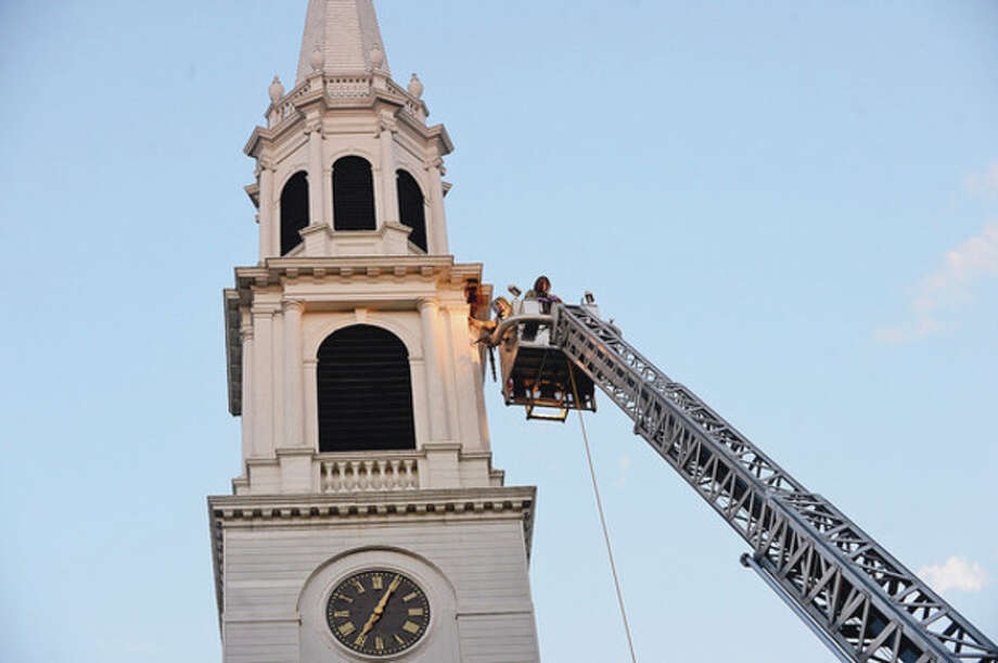 Beekeepers Andrew and Norm Cote rescue a hive of honey bees that had nested in the eaves of the steeple of the First Cogregational Church on the Green in Norwalk.Hour photo / Erik Trautmann / (C)2012, The Hour Newspapers, all rights reserved