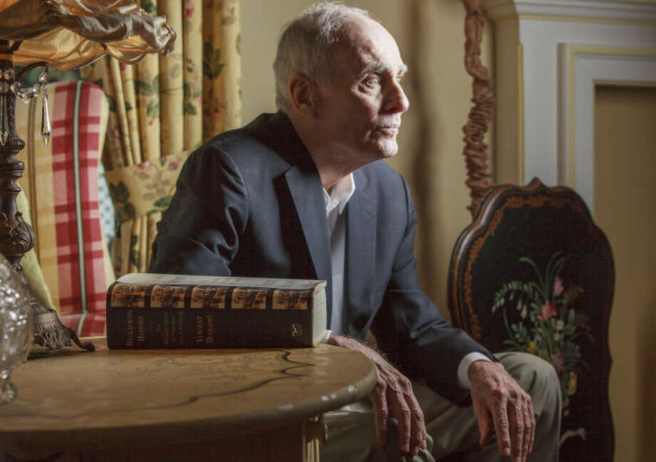 "Former Los Angeles prosecutor Vincent Bugliosi sits next to his book: ""Reclaiming History: The Assassination of President John F. Kennedy"" at his home in Pasadena, Calif. on Thursday, March 7, 2013. Bugliosi embarked on his book expecting to vindicate the Warren Commission. What he didn't expect was for it to balloon into 1,650-pages. The 78-year-old lawyer blames the conspiracy theorists. He says, he responded to all of their allegations. ""It's a bottomless pit. It never, ever ends. And if my publisher ... didn't finally step in and say, 'Vince, we're going to print,' I'd still be writing the book."" (AP Photo/Damian Dovarganes)"