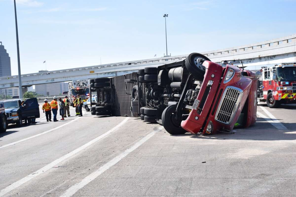 San Antonio emergency crews have closed the interchange from Interstate 35 to Interstate 10 downtown after a big rig rolled over on Wednesday, June 15, 2016.