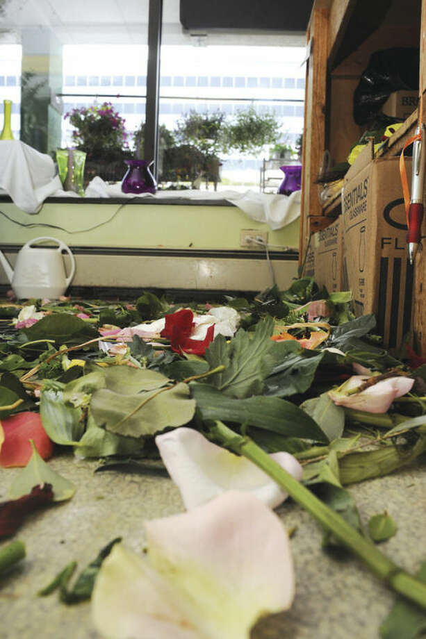 The busy floor at Bruce's Flowers in Norwalk as employees cut amd arrange flowers for the Mother's Day orders on Sunday. hour photo/Matthew Vinci