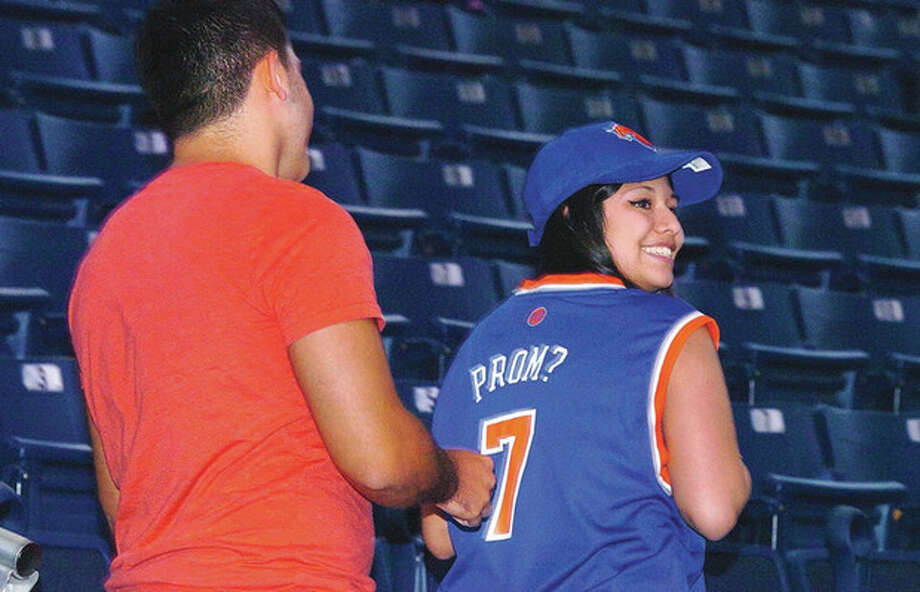 Norwalk High Senior Jessica Jarmillo shows her special Nicks jersey after she asked her boyfriend, Kevin Morales, to the prom using the Jumbo Screen at Webster Bank Arena. / 2013 The Hour Newspapers