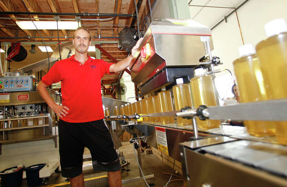 "David Bronner, of Dr. Bronner's Magic Soap, stands along side an assembly line where his ""Magic Soap"" is manufactured with a hemp oil as a key ingredient Monday, Oct. 8, 2012 in Escondido, Calif. Bronner has donated $50,000 to the campaign to legalize cultivation of hemp in the state of Washington. (AP Photo/Lenny Ignelzi) / AP"