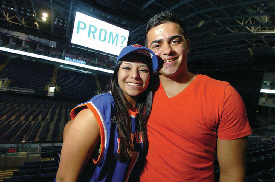 """Hour photos /Alex von KleydorffNorwalk High Senior Jessica Jarmillo asked her boyfriend, Kevin Morales, to the prom using the Jumbo Screen at Webster Bank Arena. With help from Michael Foley, director of communications at the arena, Kevin said """"Yes."""" / 2013 The Hour Newspapers"""