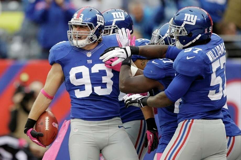 New York Giants middle linebacker Chase Blackburn (93) celebrates with teammates after intercepting a pass in the endzone during the second half of an NFL football game against the Cleveland Browns Sunday, Oct. 7, 2012, in East Rutherford, N.J. The Giants won the game 41-27. (AP Photo/Kathy Willens) / AP