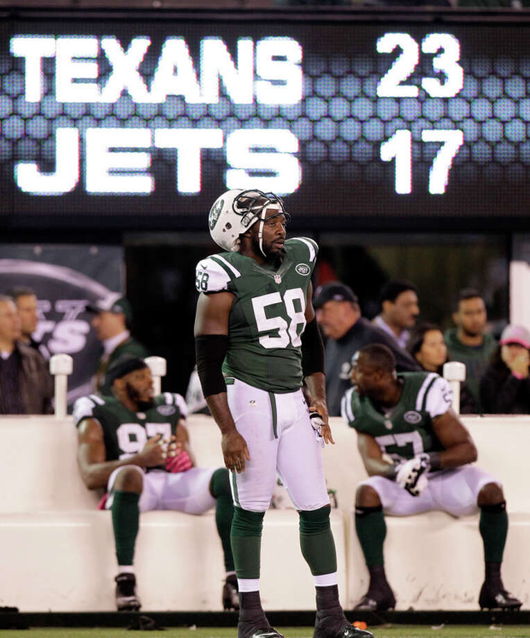 In this photo taken Monday, Oct. 8, 2012, New York Jets' Bryan Thomas (58) and teammates Bart Scott (57) and Calvin Pace (97) watch from the sidelines late in the second half of their 23-17 loss to the Houston Texans in an NFL football game in East Rutherford, N.J. Some of the Jets' biggest flaws were on full display in their loss to the Texans. They couldn't run, the defense couldn't stop the run and Tebow still isn't getting on the field much. (AP Photo/Kathy Willens, File) / AP