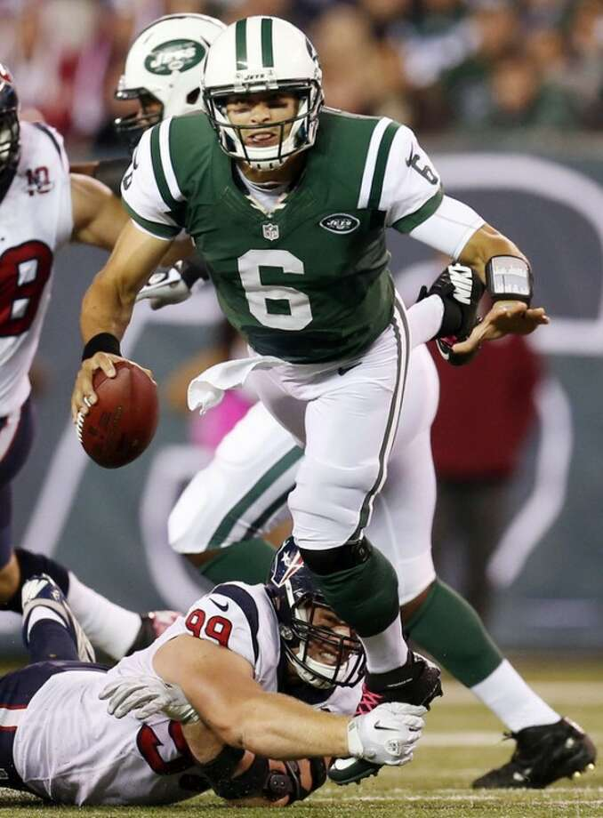 Houston Texans defensive end J.J. Watt (99) tackles New York Jets quarterback Mark Sanchez (6) during the second half of an NFL football game, Monday, Oct. 8, 2012, in East Rutherford, N.J. The Texans won 23-17. (AP Photo/Julio Cortez)
