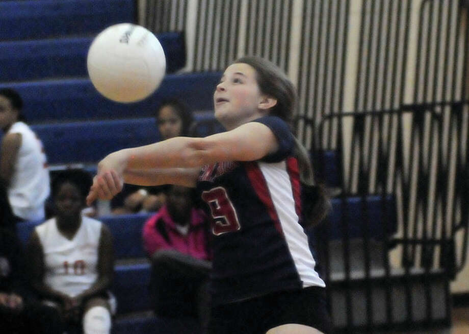 Hour photo/Matthew VinciBrien McMahon's Emily Rooney bumps the ball during Tuesday's match against Bridgeport Central at the BMHS gym. The Senators handed the visiting Hilltoppers a 3-0 defeat.