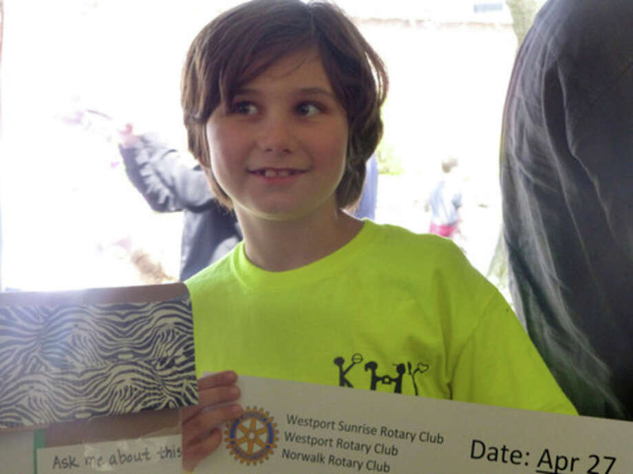 "Contributed photo Marco Volpitta, 11, won a $1,000 prize for the Solar Cookie he helped build as part of ""Kids Helping Kids"" during the recent Maker Faire in Westport."