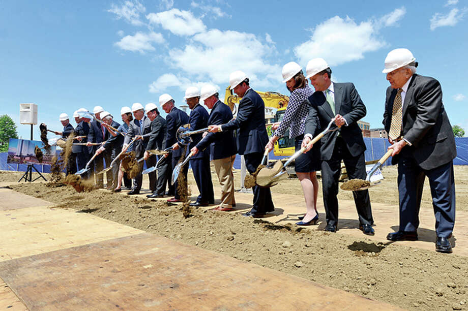 Local dignitaries join Stamford Hospital executives, board members and members of its staff as they break ground during a special ceremony for the new $450 million hospital Tuesday. Hour photo / Erik Trautmann / (C)2013, The Hour Newspapers, all rights reserved