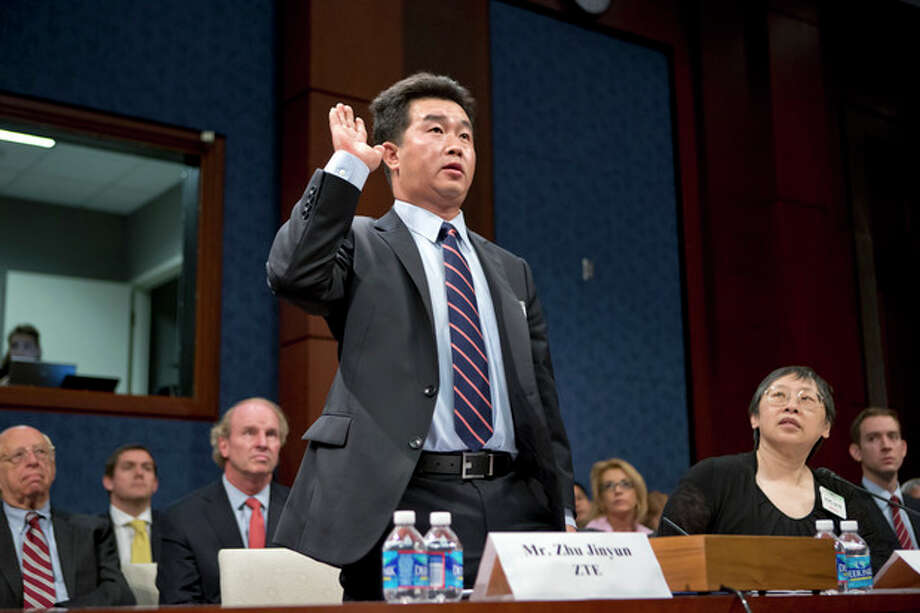 FILE - In this Sept. 13, 2012, file photo, Zhu Jinyun, ZTE Corporation's senior vice president for North America and Europe, is sworn in on Capitol Hill in Washington, prior to testifying before the House Intelligence Committee as lawmakers probe whether Chinese tech giants' expansion in the U.S. market pose a threat to national security. In a report to be released Monday, Oct. 8, 2012, the House Intelligence Committee is warning that China's two leading technology firms pose a major security threat to the United States. The panel says regulators should block mergers and acquisitions in the U.S. by Huawei Technologies Ltd. and ZTE Corp. It also advises that U.S. government systems not include equipment from the two firms, and that private U.S. companies avoid business with them. (AP Photo/J. Scott Applewhite, File) / AP