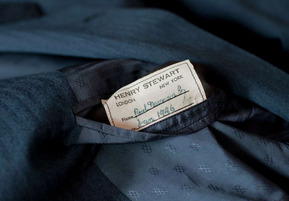 """A tailor's tag with the name """"Paul Newman"""" is seen on a suit found by Peter Gamlen in the basement of his apartment in New Haven, Conn., Tuesday, Oct. 9, 2012. Gamlen believes the suit belonged to the actor. (AP Photo/Jessica Hill) / FR125654 AP"""