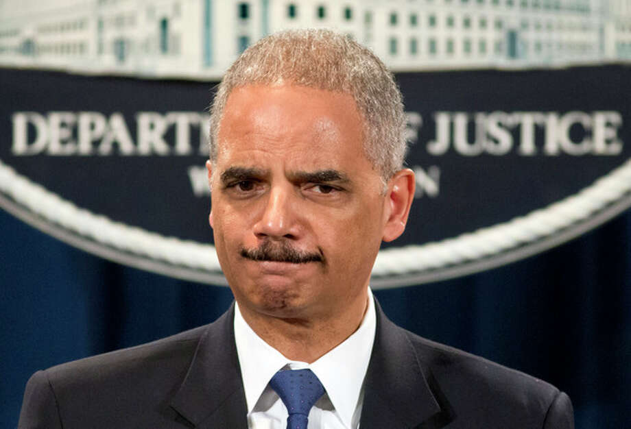 """Attorney General Eric Holder is questioned about the Justice Department secretly obtaining two months of telephone records of reporters and editors for The Associated Press, during a news conference at the Justice Department in Washington, Tuesday, May 14, 2013. In what the news cooperative's top executive called a """"massive and unprecedented intrusion,"""" the Justice Department monitored outgoing calls for the work and personal phone numbers of individual reporters, for general AP office numbers in New York, Washington and Hartford, Conn., and for the main number for the AP in the House of Representatives press gallery, according to attorneys for the AP. (AP Photo/J. Scott Applewhite) / AP"""