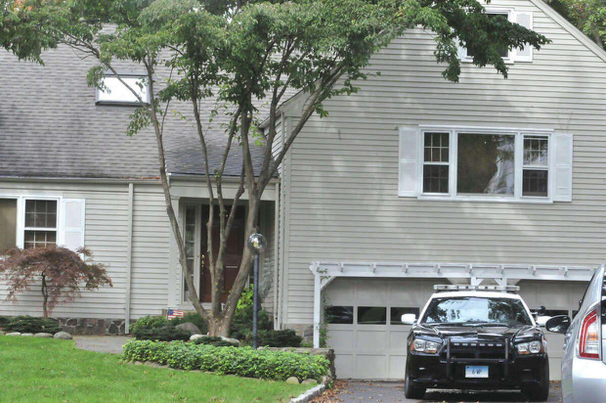 Police outside the home on Rustic lane in Westport Monday. hour photo/Matthew Vinci