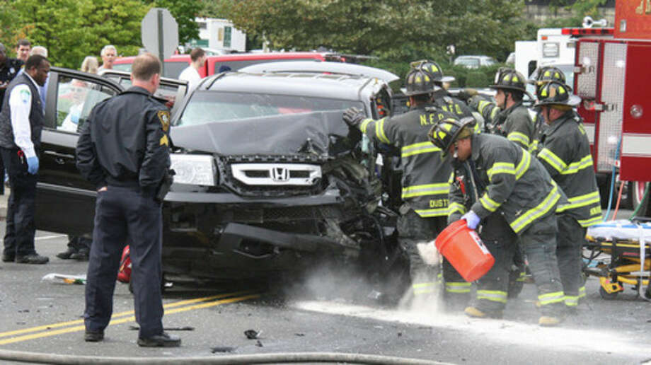 Hour Photo by Chris BosakNorwalk firefighters respond to an accident on North Avenue (US Route 1) in Norwalk on Monday afternoon. Five victims were transported to Norwalk Hospital, but no serious injuries were reported.