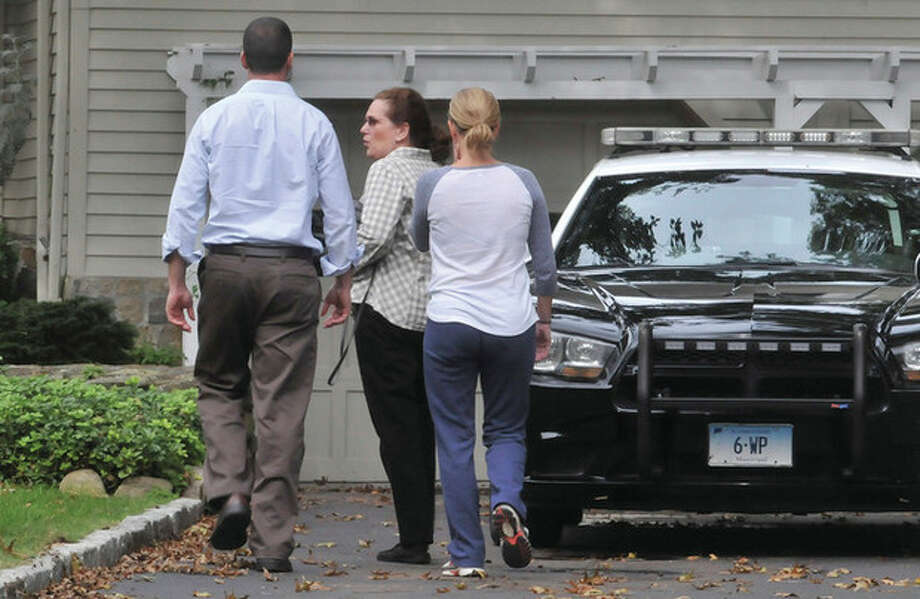 Family gather outside the home on Rustic lane in Westport Monday. hour photo/Matthew Vinci