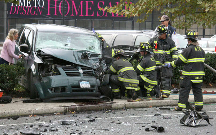 Hour Photo by Chris BosakNorwalk firefighters in action following an accident on North Avenue (US Route 1) in Norwalk on Monday afternoon. Five victims were transported to Norwalk Hospital, but no serious injuries were reported.