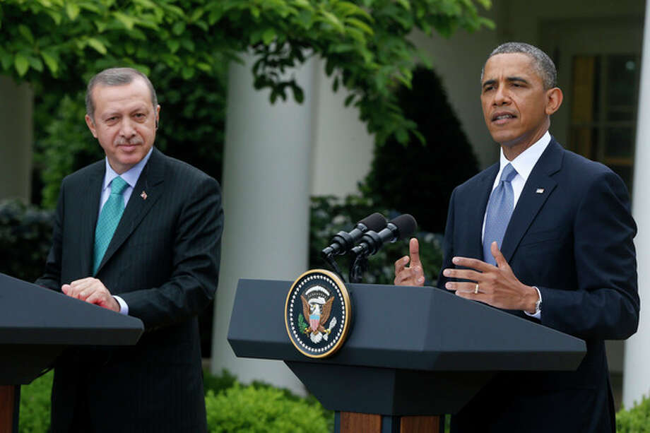 President Barack Obama, accompanied by Turkish Prime Minister Recep Tayyip Erdogan gestures during their joint news conference, Thursday, May 16, 2013, in the Rose Garden of the White House in Washington. (AP Photo/Charles Dharapak) / AP