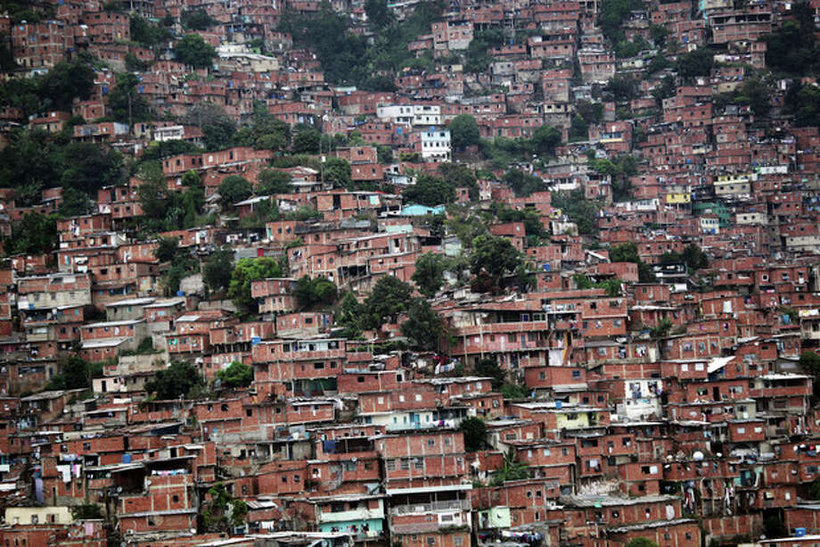 Homes cover a hill in the Petare neighborhood of Caracas, Venezuela, Friday, Oct. 5, 2012. The last time he ran for re-election, President Hugo Chavez won comfortably in Petare, one of Latin America's biggest slums with nearly half a million people. This time around, as Venezuelans vote Sunday, he may not. The neighborhood is divided, owing in some degree to mismanagement by pro-Chavez mayors and governors who were voted out of office in 2008 and 2010, respectively. (AP Photo/Rodrigo Abd) / AP