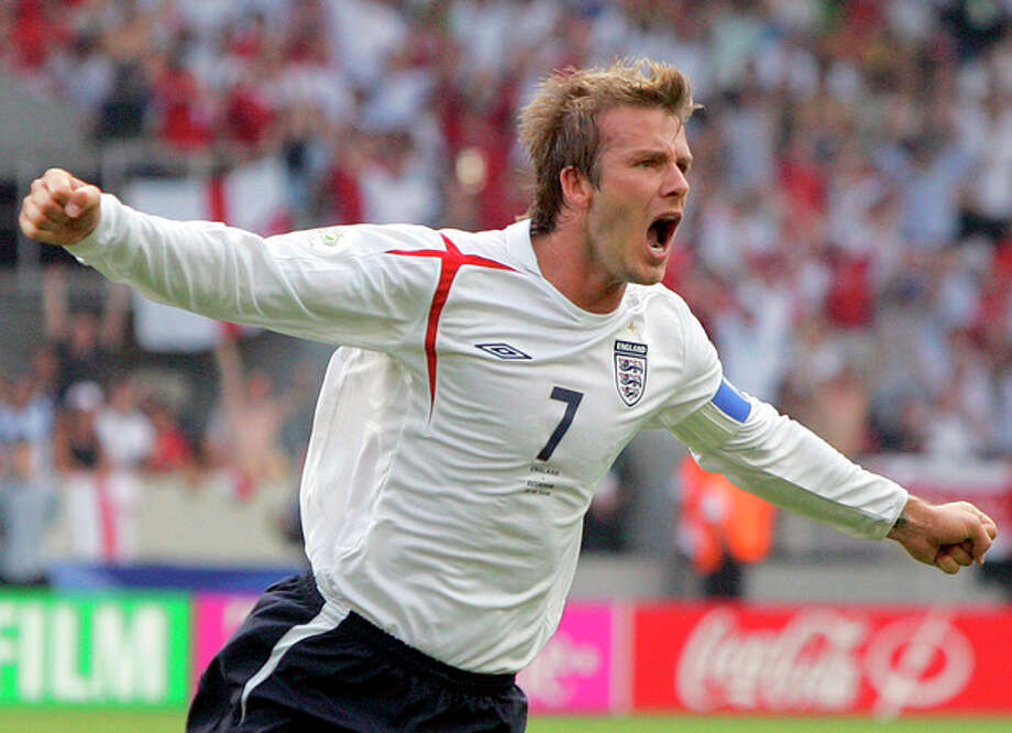 FILE - In this June 25, 2006 file photo, England's David Beckham celebrates after scoring the opening goal during the Round of 16 World Cup soccer match against Ecuador in Stuttgart, Germany. Beckham says he is retiring from soccer at the end of the season. The 38-year-old Beckham recently won a league title in a fourth country with Paris Saint-Germain. He has become a global superstar since starting his career at Manchester United. (AP Photo/Matt Dunham, FIle) / AP