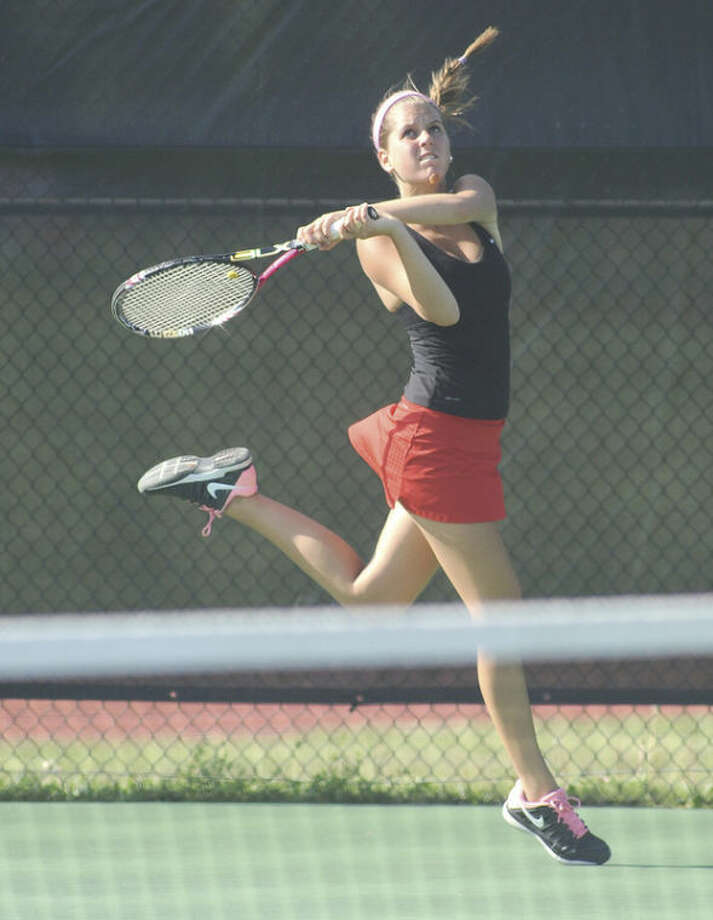 Hour photo/John NashNew Canaan's Kristin Laub hits a lob shot from the baseline during her first doubles match against Wilton in Thursday's FCIAC girls tennis quarterfinal.