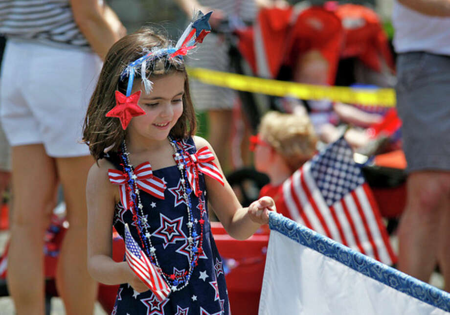 Hour file photoPeyton Ambrose, 5, smiles as she marches for United Church's Nursery School during Rowayton's annual Memorial Day Parade in 2012.