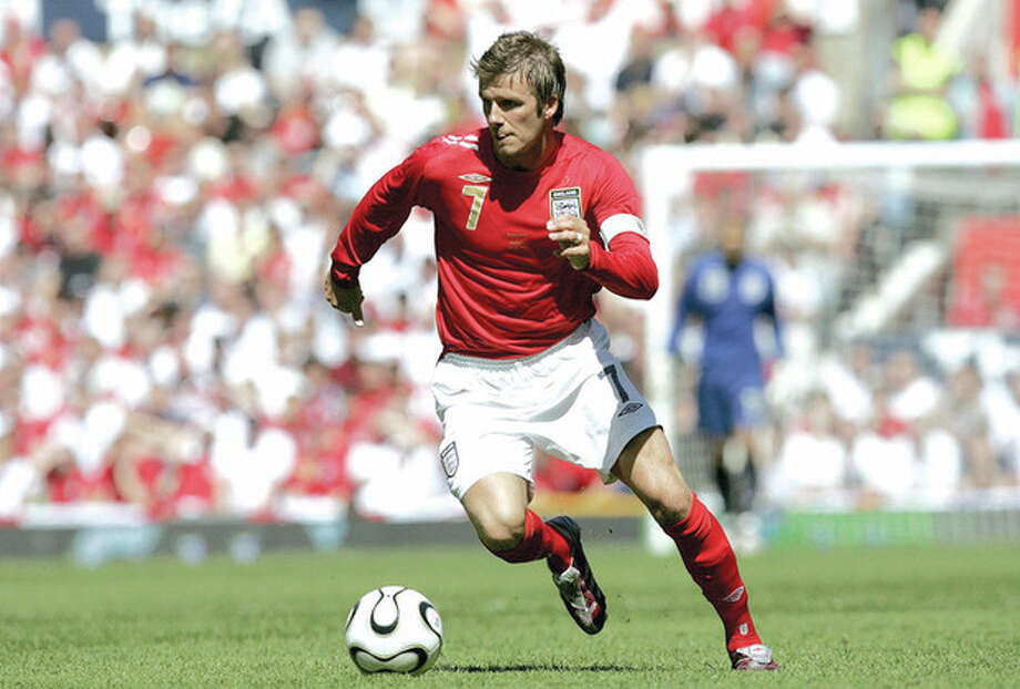 AP file photoEngland's David Beckham dribbles the ball against Jamaica during a 2006 international friendly soccer match at Old Trafford Stadium in Manchester, England. The 38-year-old midfielder, who recently won a league title in a fourth country with Paris Saint-Germain, said Thursday he will retire after the season. / AP