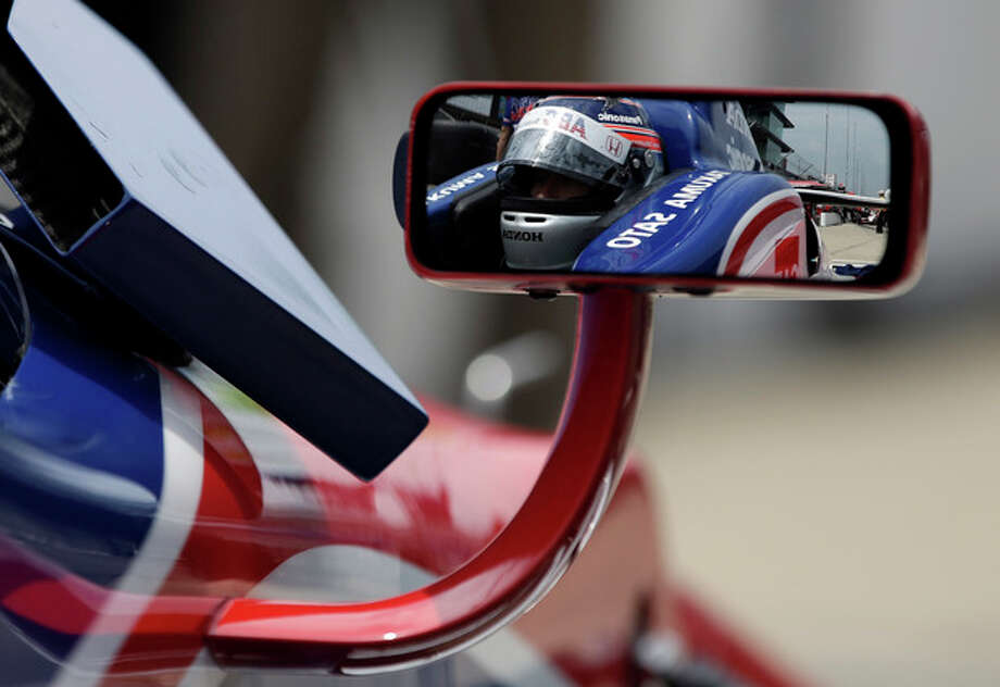 Takuma Sato, of Japan, is reflected in the mirror of his car during a break in practice for the Indianapolis 500 auto race at the Indianapolis Motor Speedway in Indianapolis, Thursday, May 16, 2013. (AP Photo/Darron Cummings) / AP