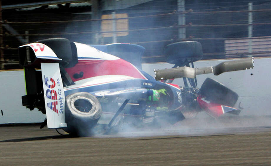 The car driven by Conor Daly slide down the track after hitting the wall in the first turn during practice for the Indianapolis 500 auto race at the Indianapolis Motor Speedway in Indianapolis, Thursday, May 16, 2013. Daly was not injured. (AP Photo/Joe Watts) / AP